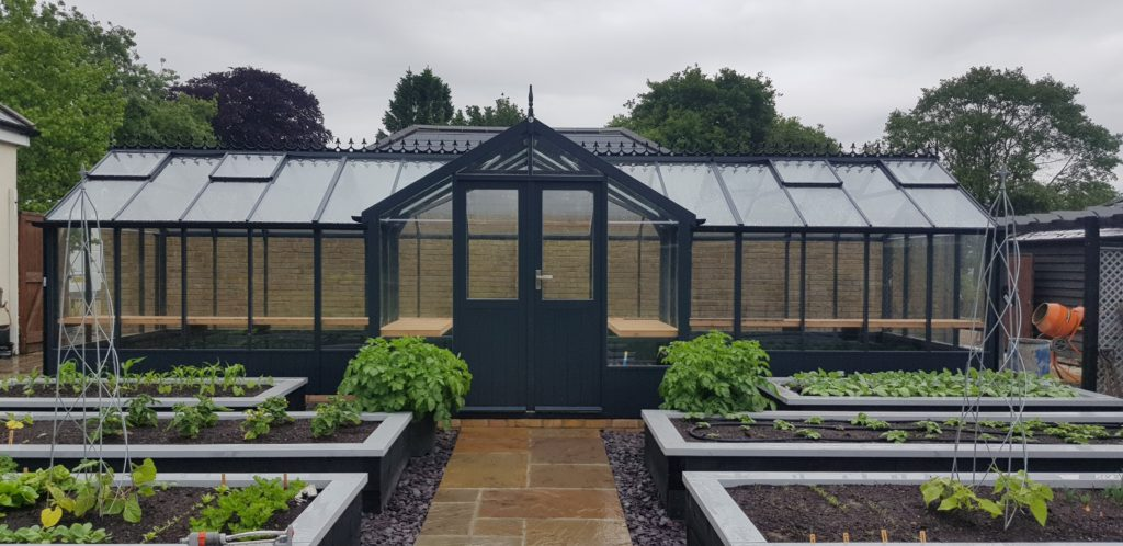 Swan 8'9 x 30'1 greenhouse with optional 4'5 porch and painted Midnight